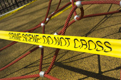 Crime scene at the park. Crime scene tape in playground Stock Photos