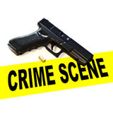 Crime scene with pistol hand gun weapon , expelled round and crime scene tape on a white background. 3d rendering. Crime scene with pistol hand gun weapon Royalty Free Stock Photos