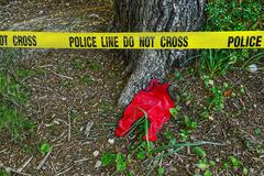 Crime scene: Police line do not cross tape. And romper suit as evidence Stock Photography
