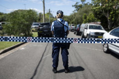 Crime scene. A policewoman stands guard at a crime scene royalty free stock photography
