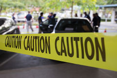Crime scene protect by caution tape. Vehicle crime scene protect by yellow caution tape stock photography