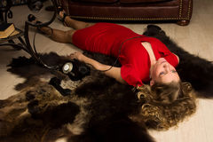 Crime scene simulation: lifeless blonde lying on the floor Stock Photo