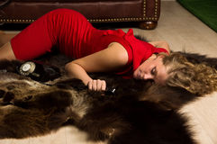 Crime scene simulation: lifeless blonde lying on the floor Stock Photography