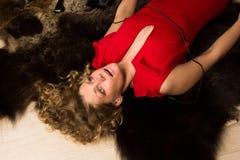Crime scene simulation: lifeless blonde lying on the floor Stock Image