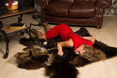 Crime scene simulation: lifeless blonde lying on the floor. Crime scene simulation: lifeless blonde in the red dress lying on the floor stock images