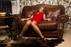 Crime scene simulation: lifeless blonde lying on the sofa Royalty Free Stock Images
