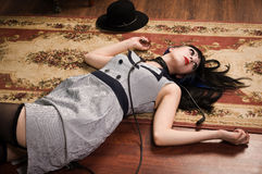 Crime scene simulation: lifeless brunette on the floor Royalty Free Stock Photo