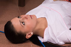 Crime scene simulation. Nurse lying on the floor Stock Image