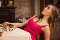 Crime scene simulation. Poisoned girl lying on the table Royalty Free Stock Images