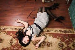 Crime Scene Simulation: Strangled Brunette On The Floor Royalty Free Stock Photography