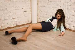 Crime scene simulation. Victim lying on the floor Stock Image