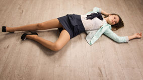 Crime scene simulation. Victim lying on the floor Royalty Free Stock Photography