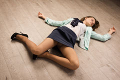 Crime scene simulation. Victim lying on the floor. Crime scene simulation: college girl lying on the floor royalty free stock photo