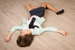 Crime scene simulation. Victim lying on the floor Royalty Free Stock Images