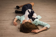 Crime scene simulation. Victim lying on the floor Royalty Free Stock Photos
