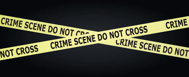 Crime scene tape. On the black background Royalty Free Stock Image