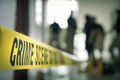 Crime scene tape with blurred forensic law enforcement backgroun Royalty Free Stock Photos
