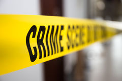 Crime scene tape in building with blurred background. Focus on 'crime Royalty Free Stock Images