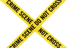 Crime Scene Tape with Clipping Path. Crossed yellow crime scene tape with a clipping path for designers Stock Photos