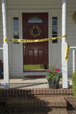 Crime scene tape at entrance to a residence Royalty Free Stock Photos