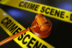 Crime scene tape and gavel. Legal gavel and police crime scene tape royalty free stock photo