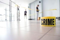 Crime scene. Tape and law enforcement background indoor Stock Photography