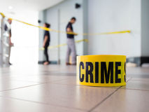 Crime scene. Tape and law enforcement background indoor Stock Images