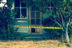 Crime scene tape near the house stock photos