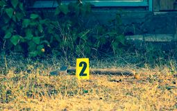 Crime scene, yellow marker evidence, an axe royalty free stock photography