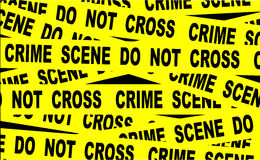 Crime Scene Tape. A typical CRIME SCENE DO NOT CROSS streamer Royalty Free Stock Photo