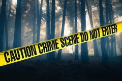 Crime scene in the woods. Crime scene tape in the woods stock images
