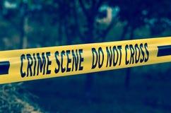Crime scene yellow police tape closeup stock photography