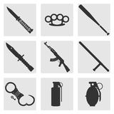 Crime and street weapons. Set of icons. Silhouette of a truncheon, knife, brass knuckles, machine gun, grenades, handcuffs. Flat vector symbols vector illustration