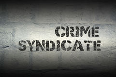 Crime syndicate gr. Crime syndicate stencil print on the grunge white brick wall Stock Photography