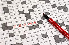 Crime. Text in crossword. Red letters royalty free stock photos