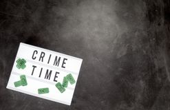 Crime time and movie tickets with copy space. Crime time written on a word board with movie admission tickets and copy space Royalty Free Stock Photography