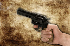 Crime and violence. Conception of crime and violence. hand with gun,sepia toned Stock Photo