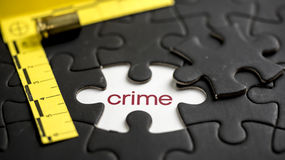 Crime. Word crime under jigsaw puzzle piece Stock Photo