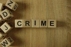 Crime word from wooden blocks. On desk stock image