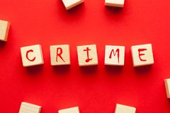 Crime written in cubes. Crime word written on cubes shape wooden blocks on red background royalty free stock images