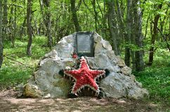 Crimea, Bakhchisaray district, Russia, May, 05, 2017. Memorial stone on location in 1941-1942 years Ak-Mechetsky guerrilla group. Crimea, Bakhchisaray district Royalty Free Stock Photos
