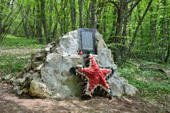 Crimea, Bakhchisaray district, Russia, May, 05, 2017. Memorial stone on location in 1941-1942 years Ak-Mechetsky guerrilla group. Crimea, Bakhchisaray district Royalty Free Stock Photo