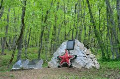 Crimea, Bakhchisaray district, Russia, May, 05, 2017. Memorial stone on location in 1941-1942 years Ak-Mechetsky guerrilla group. Crimea, Bakhchisaray district Stock Image