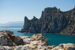 Crimean rock. Black sea and blue sky. stock photo