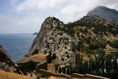 Crimea.Fortress Sudak. Fortress in Crimea on the seashore on a sunny summer day royalty free stock images