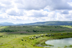 Crimea Landscape. The picturesque landscape of the Crimea, with mountains, green hills, lake, near Belogorsk Stock Images