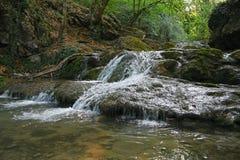 Crimea mountain streams. Crimea mountain waterfall in sunny day Royalty Free Stock Photo