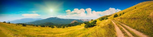 Crimea mountain valley pano. Road through the Crimea sunny mountain valley Stock Photo