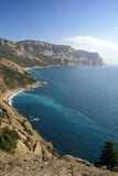 Crimea mountains dipping in Black sea Royalty Free Stock Photos