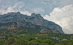 Crimea mountains. Dramatic summer sky with clouds Stock Images